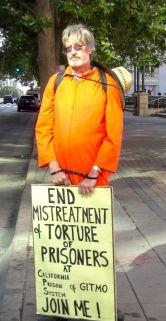 Vigiler in orange jump suit