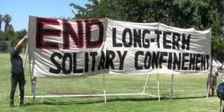 Banner: End Long Term Solitary Confinement