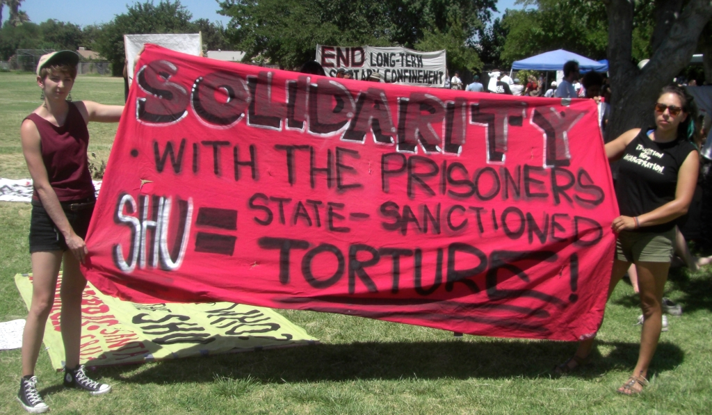 """Photo of banner """"Solidarity with the Prisoners"""""""